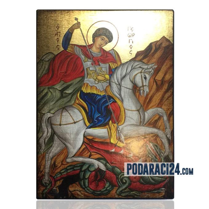 Ръчна изработка на икона на св. Георги върху дърво.